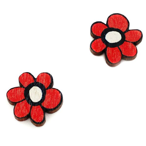 Kauniit Suomessa suunnitellut ja valmistetut puiset nappikorvakorut Kukkaralla-kuosin puna-mustilla kukilla.